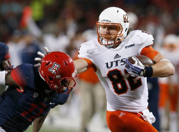 UTSA tight end David Morgan II (82) stiff arms Arizona safety Will Parks during the first half of an NCAA college football game, Thursday, Sept. 3, 2015, in Tucson, Ariz. (AP Photo/Rick Scuteri)