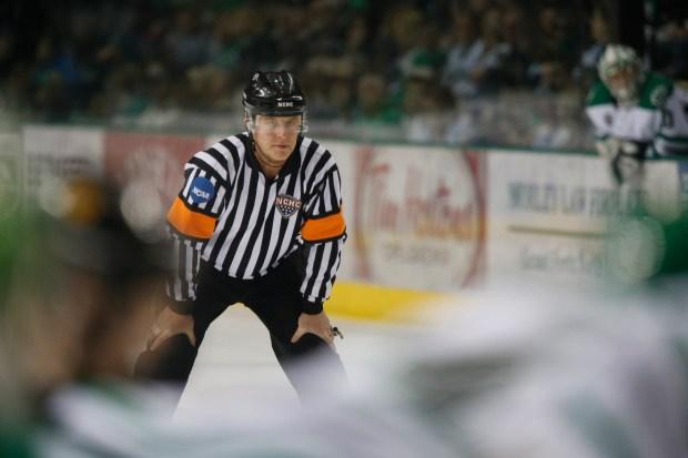 Derek Shepherd refereeing at Ralph Engelstad Arena. (Jesse Trelstad/ Grand Forks Herald)