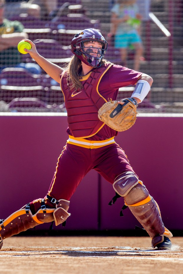 University of Minnesota softball player LeMay Taylor, the team's catcher, is shown in action. Photo courtesy of University of Minnesota Athletics.