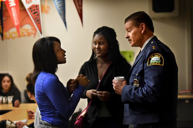 Mariya Johnson, 16, left, who wants to be either a police officer or a detective, seeks advice from St. Paul Police Chief Thomas Smith at Humboldt High School in St. Paul on Friday, April 22, 2016. In the center is Archeion Miles, 15. Smith, a Humboldt grad, met with the Humboldt Girls Leadership where he has been helped mentor for about 10 years. (Pioneer Press: Jean Pieri)