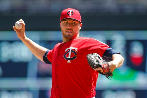 Minnesota Twins starting pitcher Phil Hughes pitches to the Toronto Blue Jays in the first inning of a baseball game Sunday, May 22, 2016, in Minneapolis. (AP Photo/Bruce Kluckhohn)