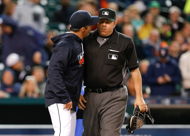 Detroit Tigers manager Brad Ausmus, left, yells at home plate umpire Jeff Nelson against the Minnesota Twins in the fourth inning. Ausmus was thrown out of the game. (AP Photo/Paul Sancya)