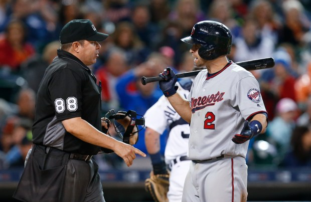 Minnesota Twins' Brian Dozier (2) reacts to a called third strike by umpire Doug Eddings (88) in the seventh inning. (AP Photo/Paul Sancya)