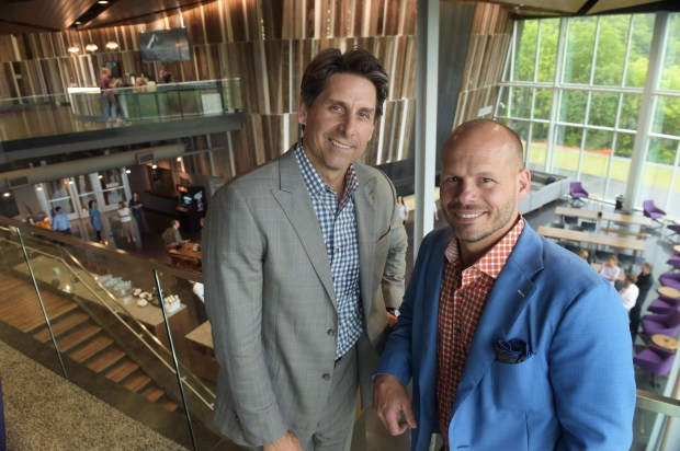 "Anytime Fitness CEO and co-founder Chuck Runyon, left, and president and co-founder Dave Mortenson, held a grand opening of their new corporate building in Woodbury, which they call the ""fittest building in America"", Wednesday, May 25, 2016.  (Pioneer Press: Scott Takushi)"
