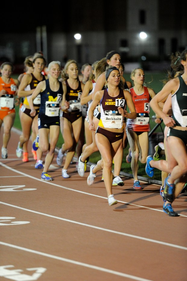 Liz Berkholtz runs during the 10K race at the Big Ten outdoor meet. Berkholtz (#12) finished runner-up in 10,000-meter run to help Minnesota win the conference team title. (Courtesy of Becky Miller/Gopher Athletics)