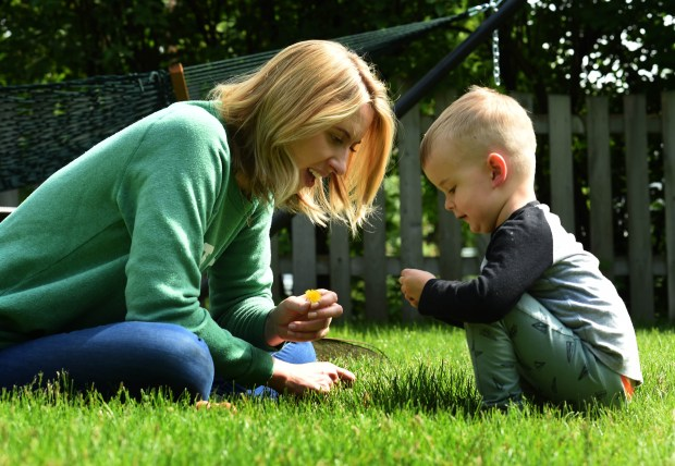 """Nora McInerny Purmort, author of """"It's OK to Laugh (Crying is Cool Too), plays with her son Ralph, 3, at her home in Richfield on Monday, May 16, 2016. (Pioneer Press: Scott Takushi)"""