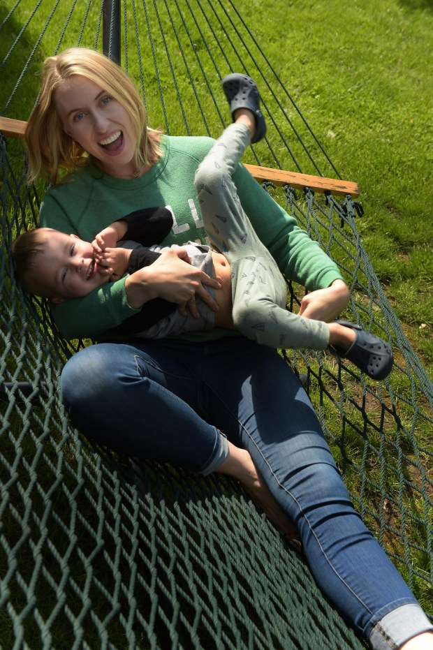 """Nora McInerny Purmort, author of """"It's OK to Laugh (Crying is Cool Too), plays with her son Ralph, 3, at her home in Richfield, Mn., Monday, May 16, 2016. (Pioneer Press: Scott Takushi)"""