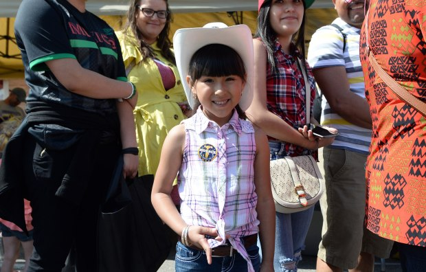 A little girl wearing a cowboy hat enjoys the Cinco De Mayo parade along Cesar Chavez Street on St. Paul's West Side on Saturday, May 7, 2016. (Pioneer Press: John Autey)