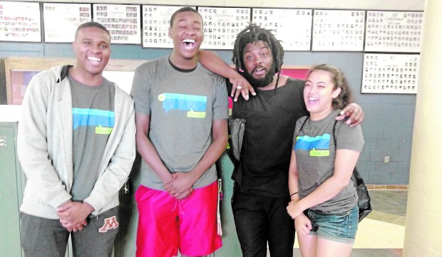 Jason Reynolds, second from right, was escorted at Teen Lit Con by Sibley Senior High seniors William Stevenson, left, and Roy Mack, and junior Laniesha Berg at Sibley High School, Mendota Heights, May 7, 2016. (Courtesy photo)