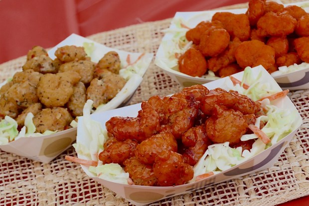 Saucy shrimp & slaw: Breaded shrimp tossed in your choice of parmesan garlic, sweet chili or buffalo sauce on a bed of fresh coleslaw. At Fish & Chips Seafood Shoppe - Two locations: In the Food Building, northwest section, and on the west side of Liggett Street just south of Mighty Midway. (Courtesy of Minnesota State Fair)