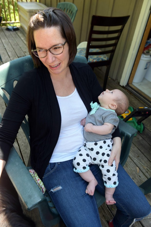 Kelsey Bumgardner holds Beatrix at home in Mendota Heights. She has been battling Guillain-Barré syndrome, a disease where the body's immune system attacks its nervous system. (Pioneer Press: Scott Takushi)