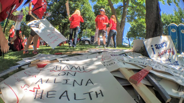 On-strike Allina Health nurses, some with family members in tow, gathered in Minneapolis' Stewart Park on Monday, June 20, during a lull in their picketing outside nearby Abbott Northwestern Hospital. (Pioneer Press: Julio Ojeda-Zapata)