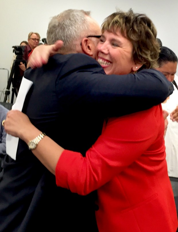 Supreme Court Justice appointee Anne McKeig, right, hugs Tim Zuel, a longtime Hennepin County child welfare colleague, after Gov. Mark Dayton announced McKeig's appointment to the high court in a St. Paul news conference on June 28, 2016. (Pioneer Press: Rachel E. Stassen-Berger)