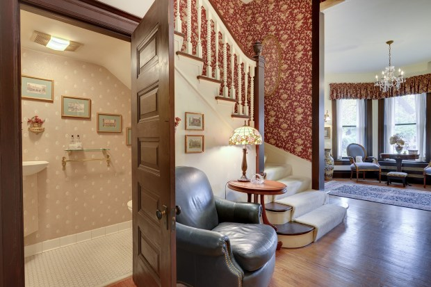 A door opens to a bathroom under a staircase at 599 Summit Ave. in St. Paul. (Courtesy of Edina Realty)