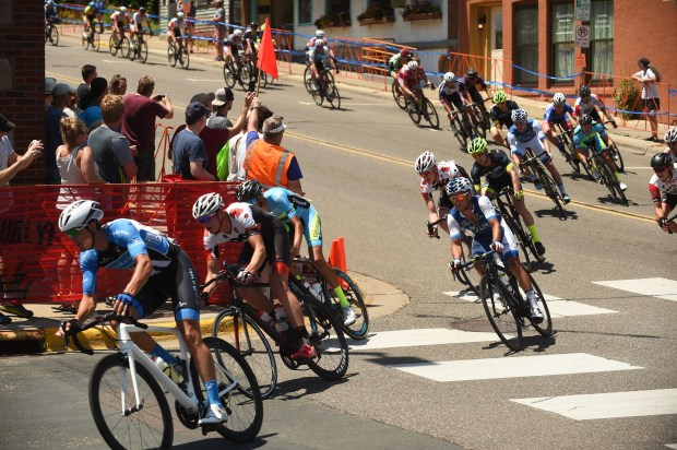 Riders descend a steep street and make a 90 degree turn at Second and Chestnut, during the men's Stillwater Criterium, the sixth and final stage of the North Star Grand Prix, Sunday, June 19, 2016 in Stillwater, Mn. (Pioneer Press: Scott Takushi)