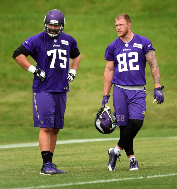 Offensive lineman Matt Kalil, left, and tight end Kyle Rudolph chat as the Minnesota Vikings held a minicamp in Eden Prairie on Tuesday, June 14, 2016. (Pioneer Press: Scott Takushi)