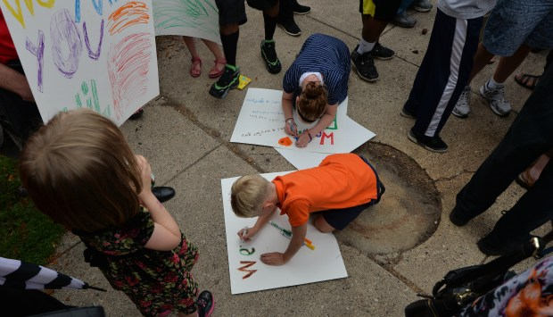 Kids make signs expressing how they miss Philando Castile during a vigil at J.J. Hill Montessori School in St. Paul on Thursday, July 7, 2016. Hundreds of people gathered to remember Philando Castile who was killed by a St. Anthony Police Officer in Falcon Heights Wednesday night. (Pioneer Press: John Autey)