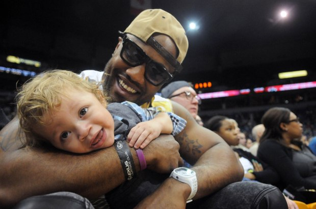 Vikings defensive end Everson Griffen holds his son Greyson, then 13 months old, courtside as the Timberwolves played Sacramento at Target Center on Sunday, March 16, 2014. The Wolves beat the Kings 104-102. (Pioneer Press: Scott Takushi)
