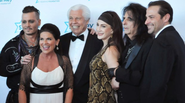 Actor Johnny Depp, left, and rocker Alice Cooper, second from right, line up for a photo with Starkey Hearing Foundation founder, owner and CEO William F. Austin, center, and his wife, Tani Austin, at the 2016 annual Starkey Awards Gala at Saint Paul's RiverCentre. Flanking Cooper are Cooper's wife, Sheryl Goddard, and an unidentified man. (Pioneer Press: Ginger Pinson)