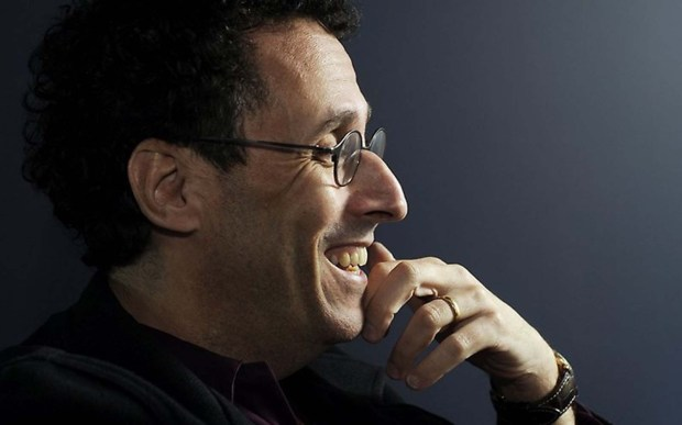 "Pulitzer Prize-winning playwright Tony Kushner is 60. He's pictured in 2009 at the Guthrie Theater, where his play ""The Intelligent Homosexual's Guide to Capitalism and Socialism with a Key to the Scriptures"" made its debut. He won the Pulitzer for ""Angels in America."" (Associated Press: Craig Lassig)"