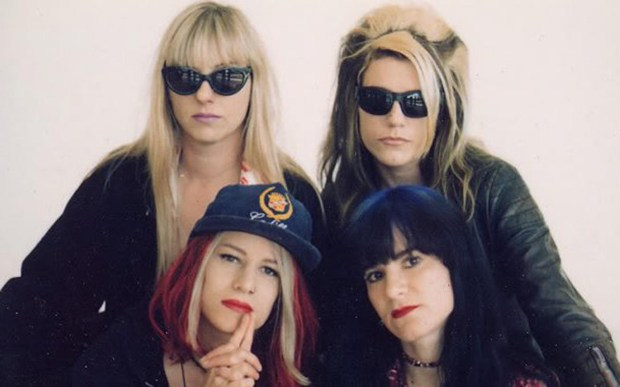 Suzi Gardner, top left, of the grungy, riot-grrl-influencing band L7, is 56. In the photo are bandmates Donita Sparks Jennifer Finch and Demetra Plakas. (Courtesy of L7official.com)