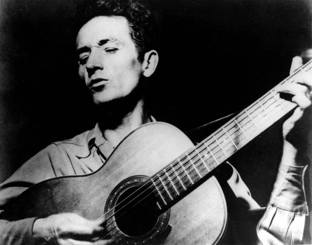 """Folk music legend Woody Guthrie was born on this day in 1912. He wrote """"This Land is Your Land"""" and many other songs that inspired the likes of Bob Dylan and Bruce Springsteen. He died of a progressive neurological disorder at age 55. (Associated Press file photo)"""