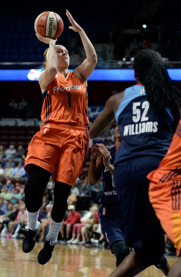 Connecticut Sun's Rachel Banham, left, shoots over Atlanta Dream's Elizabeth Williams, right, during the first half of a WNBA basketball game, Friday, June 3, 2016, in Uncasville, Conn. (AP Photo/Jessica Hill)