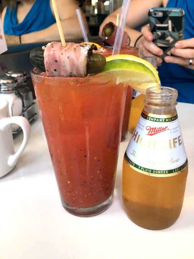 July 25, 2016 photo of the bloody Mary at Hi-Lo diner includes a little pickle slathered in cream cheese and rolled in meat, just like your favorite church basement appetizer. (Pioneer Press: Jessica Fleming)