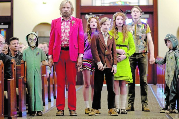 Viggo Mortenson, standing second from left, is the Captain, who has to bring his kids in from life off the grid for a funeral. (Regan MacStravic)