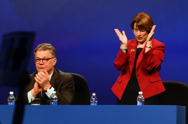 U.S. Senator Amy Klobuchar stands and applauds a point made by presumptive Democratic presidential nominee Hillary Clinton, as she speaks at the American Federation of Teachers' biennial convention in Minneapolis, Monday, July 18, 2016. At left is U.S. Senator Al Franken. (Pioneer Press: Scott Takushi)