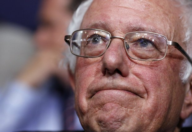 Former Democratic presidential candidate, Sen. Bernie Sanders, I-Vt., waits before asking that Hillary Clinton become the unanimous choice for President of the United States with the Vermont delegation during the second day session of the Democratic National Convention in Philadelphia, Tuesday, July 26, 2016. (AP Photo/Matt Rourke)