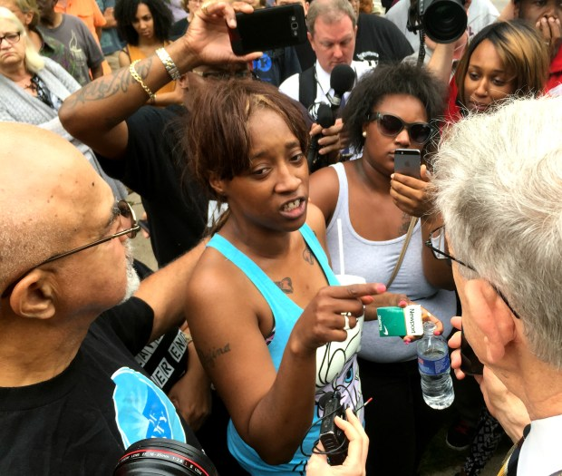 Diamond Reynolds, second from left, speaks outside the Governor's Residence in St. Paul on Thursday, July 7, 2016. Her boyfriend, Philando Castile, was shot by police Wednesday evening while she and her 4-year-old daughter were in the car. (Pioneer Press: Rachel E. Stassen-Berger)