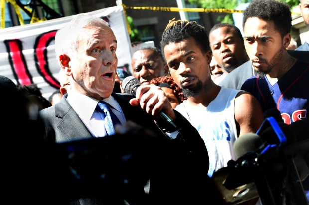 "People listen as Gov. Mark Dayton, left, speaks to people gathered outside the Governor's Residence in St. Paul on Thursday, July 7, 2016, after Philando Castile was shot by police. He promised at the time that, ""Justice will be served in Minnesota"" (Pioneer Press: Jean Pieri)"