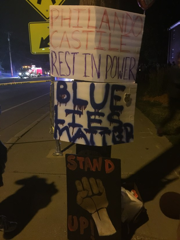 Signs were tacked up near Larpenteur Avenue and Fry Street in Falcon Heights, where Phil Castile was shot by officers during a traffic stop Wednesday, July 6, 2016. (Pioneer Press)