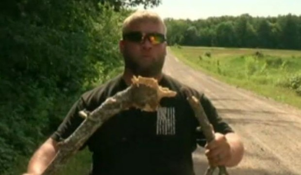 Jason Galvin of Rush City, Minn., holds the branch he shot down Thursday, June 30, 2016, to rescue a trapped eagle. (Photo taken from ABC News video)