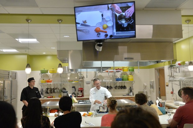 Chef Jeremy Reinicke starts his miso ginger glazed salmon dish for a full class in the kitchen classroom at the HealthEast Woodwinds Health Campus Ways to Wellness Center in Woodbury on Tuesday, June 28, 2016. (Pioneer Press: John Autey)y)