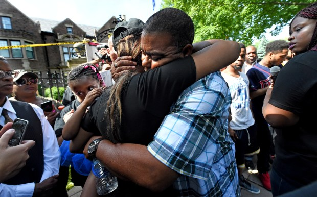 Clarence Castile, right, an uncle of shooting victim Philando Castile, hugs Castile's girlfriend Diamond Reynolds as people gather outside the Governor's Residence in St. Paul on Thursday, July 7, 2016. Philando Castile was killed after being shot by police during a traffic stop Wednesday night in Falcon Heights. Reynolds is holding her daughter Dae'Anna, 4, both witnessed the shooting. (Pioneer Press: Jean Pieri)
