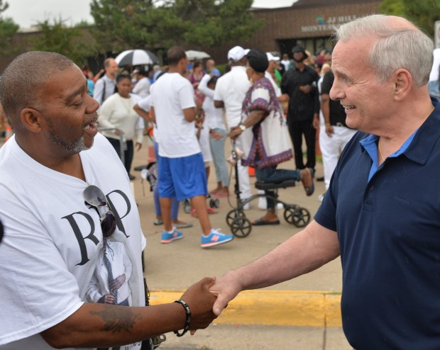 Clarence Castile, uncle of Philando Castile welcomes Governor Mark Dayton to a community meal in memory and in honor of Philando on Thursday, July 14, 2016. (Pioneer Press: John Autey)
