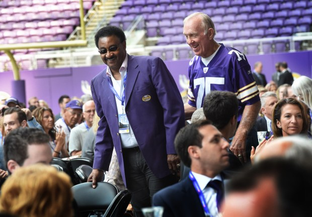 Former Vikings' greats Chuck Foreman, left, and Bob Lurtsema join the party at U.S. Bank Stadium Friday. (Pioneer Press: Jean Pieri)