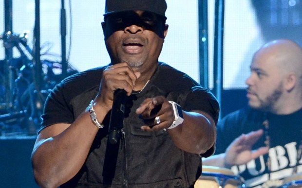 Rap DJ Terminator X, right, of Public Enemy is 50. At center is frontman Chuck D, left, at the band's Rock and Roll Hall of Fame induction in 2013. (Getty Images: Kevin Winter)