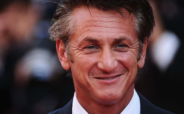 "Actor Sean Penn, 56, still looks like he's ready to order a pizza and say, ""Aloha, Mr. Hand."" (Getty Images: Ian Gavan)"