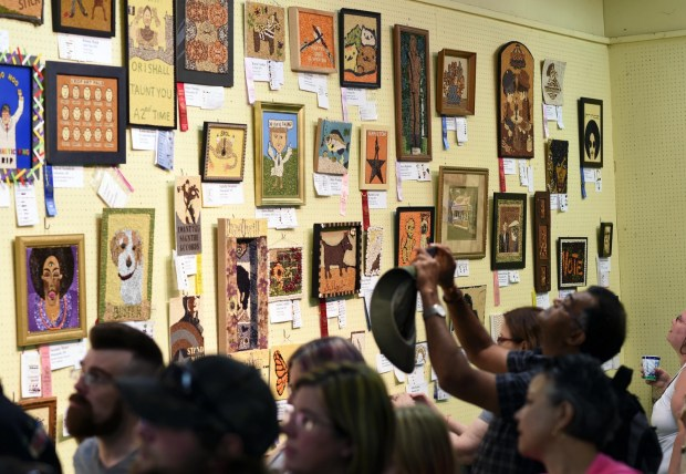 Crowds file past the crop art exhibit in the Agriculture Horticulture Building at the Minnesota State Fair, Thursday, August 25, 2016. (Pioneer Press: Scott Takushi)