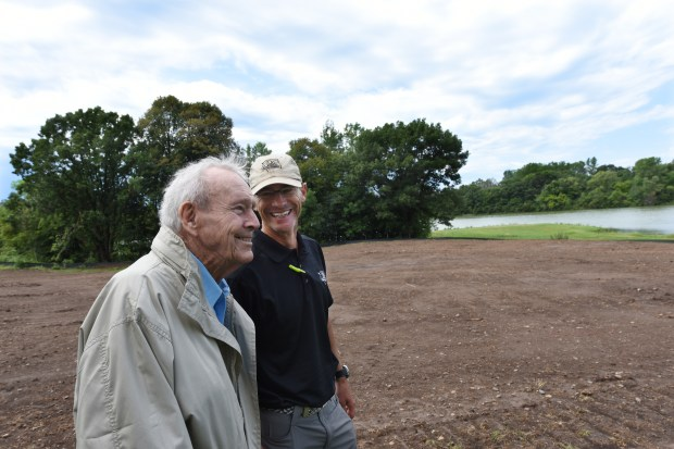 Golf legend Arnold Palmer, left, who died Sunday, Sept. 25, 2016, shares a chuckle with golf course architect Thad Layton as they look over the 18th fairway at Royal Golf Club in Lake Elmo, Minn., Thursday, Aug. 4, 2016. Scheduled to open as soon as June 2017, the former Tartan Park Golf Course is being redesigned by the firms of Palmer and golf great Annika Sorenstam. (Pioneer Press: Dave Orrick)