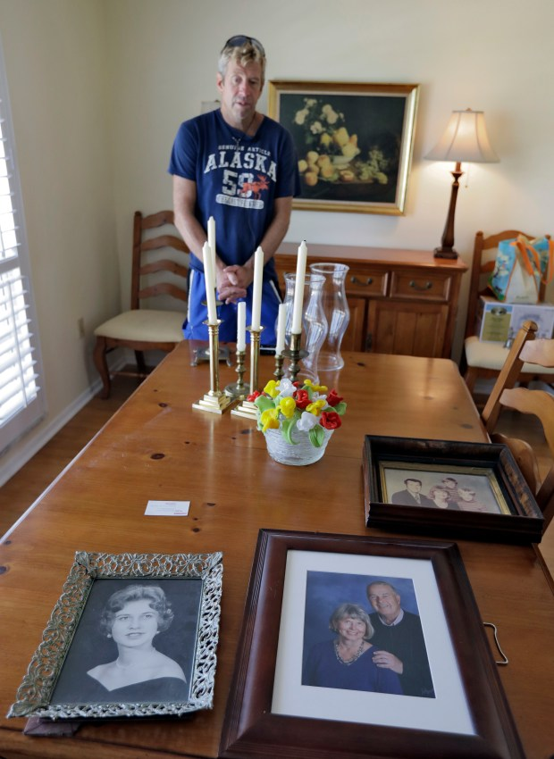 "Steve Knowlton talks about his mother Mary Knowlton, shown in family photos, during an interview Wednesday, Aug. 10, 2016, in Punta Gorda, Fla. Police say an officer accidentally shot Mary to death during a citizen's academy ""shoot/don't shoot"" exercise Tuesday evening. (AP Photo/Chris O'Meara)"