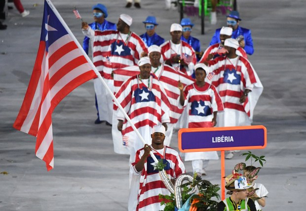 Liberia's flagbearer Emmanuel Matadi leads his delegation during the opening ceremony of the Rio 2016 Olympic Games at the Maracana stadium in Rio de Janeiro on Aug. 5, 2016. (AFP/Getty Images: Pedro Ugarte)