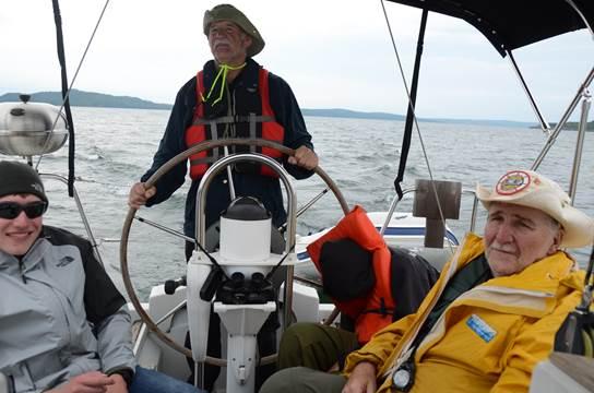 "From left, Matthew Verweg, Assistant Scoutmaster Rick Albrecht and Skipper Alfred Wolfram aboard ""La Magouille"" near Thunder Bay, Canada. (Beverly Verweg)"