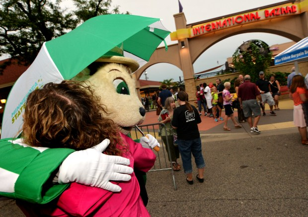 Fairchild gets a hug from a fan. The Minnesota State Fair mascot Fairchild turns 50 this year. He was photographed at the State Fair on Thursday, August 18, 2016. (Pioneer Press: John Autey)