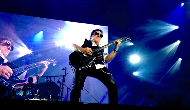 "Neal Schon of Journey pays tribute to Prince with ""Purple Rain"" on Tuesday, Aug. 9, 2016, at the Xcel Energy Center in St. Paul. (Courtesy photo)"