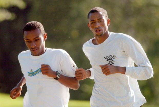 Hassan Mead, right, of Minneapolis South, the top cross country runner in boys' class AA this year, runs alongside teammate Robel Kebede during a team practice at Lake Nokomis in Minneapolis on Wednesday September 20, 2006. (Pioneer Press: Richard Marshall)