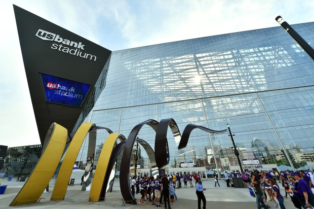 Fans explore the plaza in front of U.S. Bank Stadium before the Vikings game against the San Diego Chargers on Sunday, August 28, 2016. (Pioneer Press: John Autey)